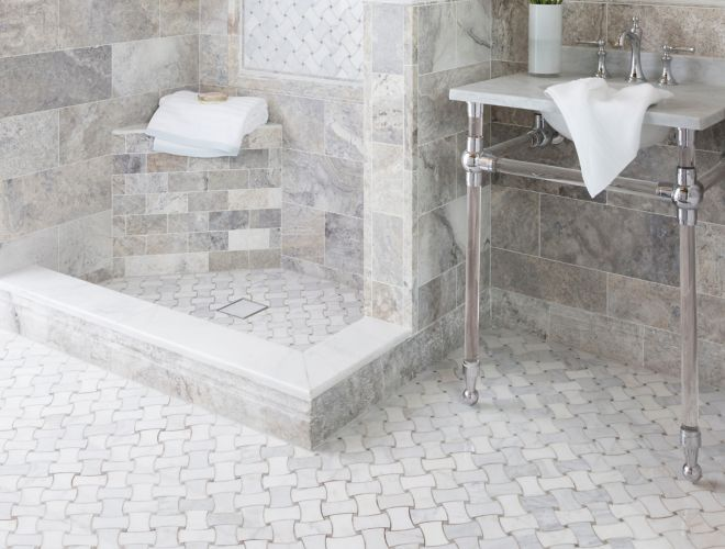 Traditional bathroom with grey travertine and marble tile.