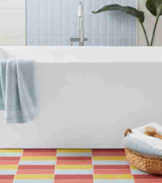 blue yellow red pink colorful tile bathroom floor
