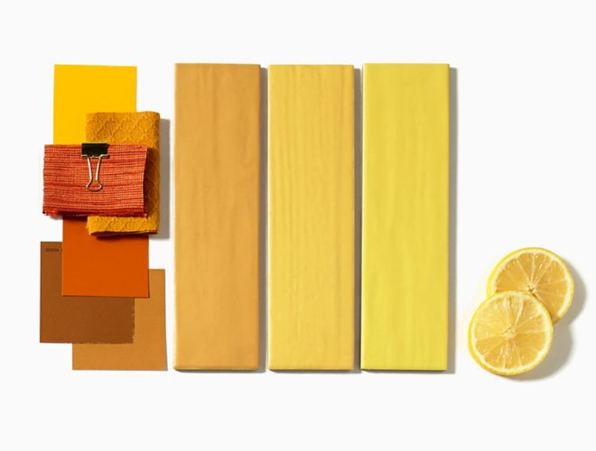 Subway tile in shades of yellow.