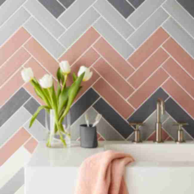 Pink and grey ceramic subway tiled bathroom.