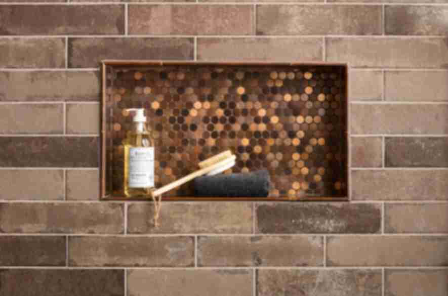 copper brick wall with shower niche.