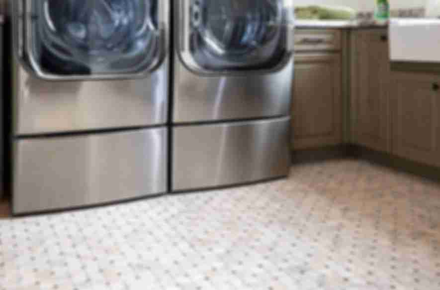 square floor tiles laundry room.