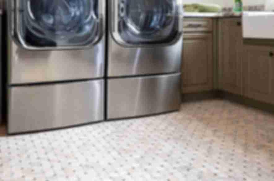 square floor tiles laundry room.