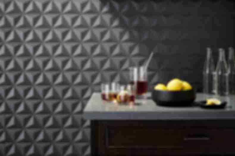 Contemporary bar with dark grey geometric 3-d tile.