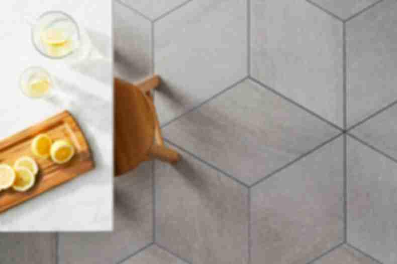 Geometric grey diamond porcelain floor tile dining room.
