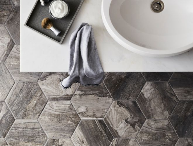 Rustic bathroom with wood look, hexagon floor tile.