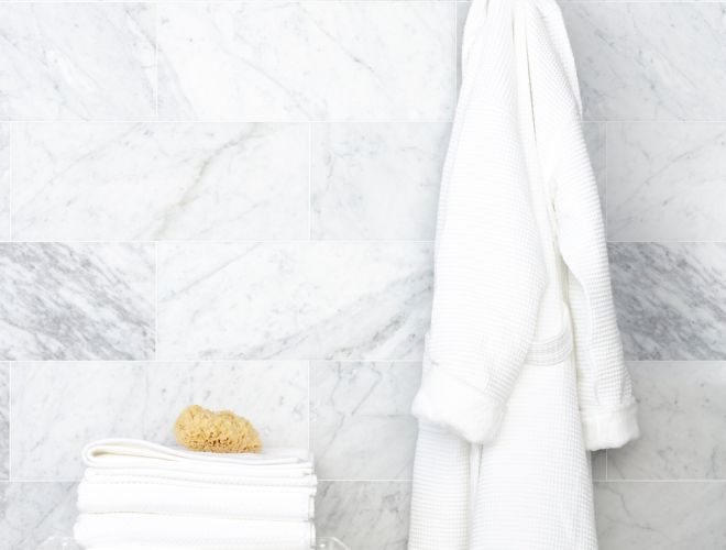White marble wall with hanging robe.