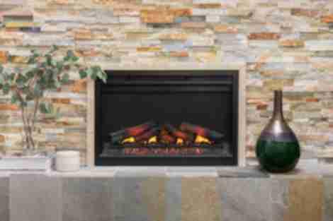 Fireplace with multi-color architectural quartzite tile.