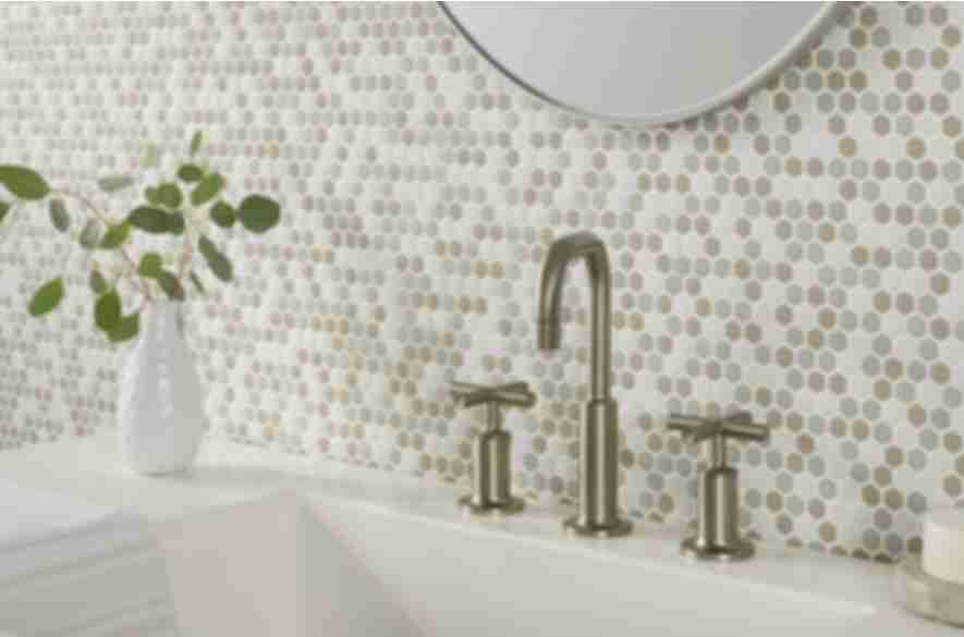 Neutral glass mosaic bathroom backsplash.