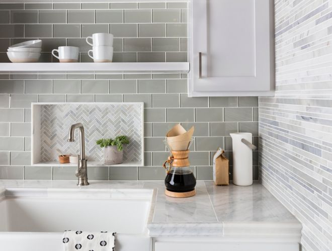 Green glass subway tile kitchen backsplash with herringbone mosaic accent.