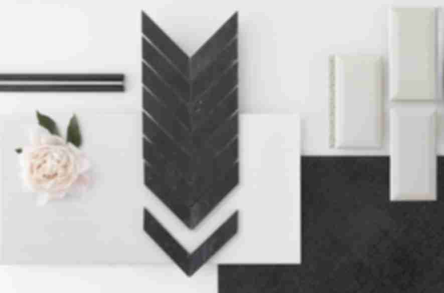 Black chevron mosaic with tile pairings.