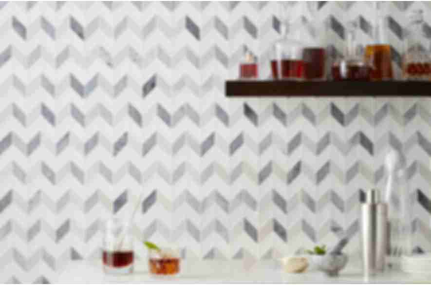 Grey and white chevron marble bar backsplash.