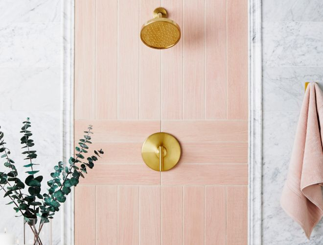 Scandinavian Chic shower with pink wood-look tile and white marble.