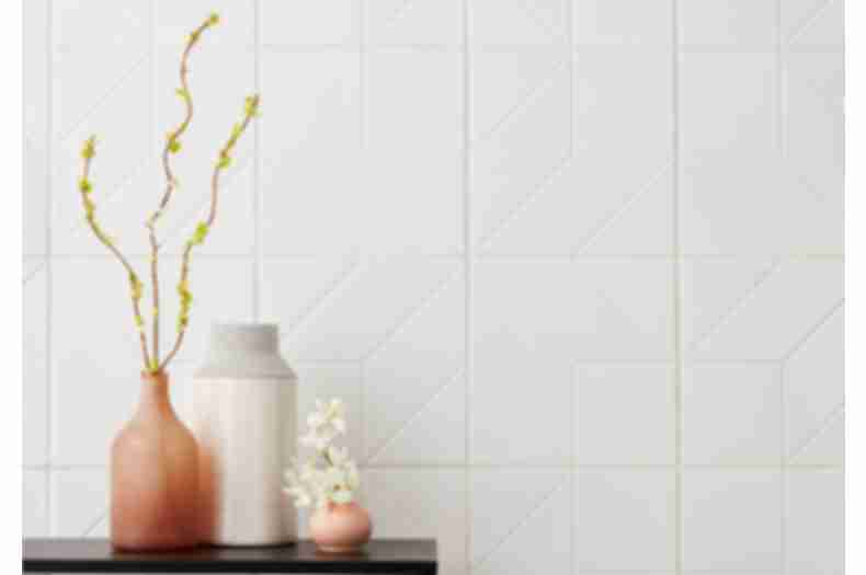 Modern and feminine entry way with white, geometric wall tile.