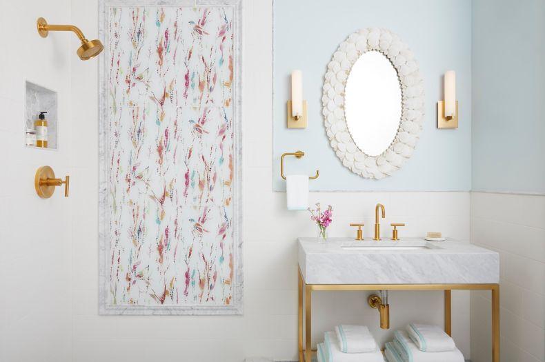 Pink and blue patterned glass tile bathroom.