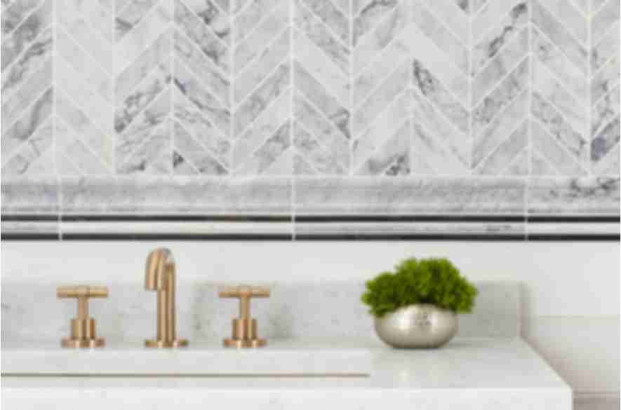 Grey chevron bathroom wall tile.
