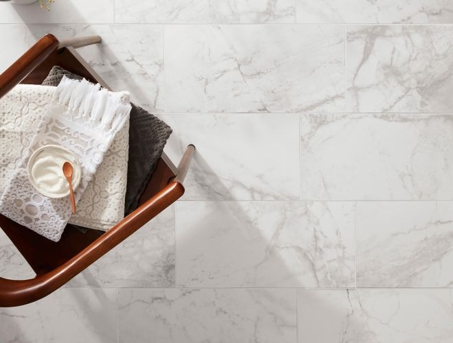 White and grey marble look flooring tile that is porcelain.