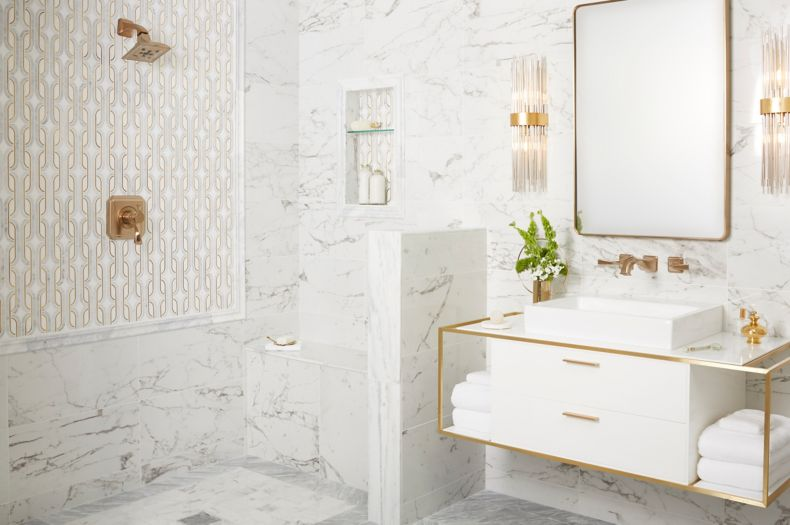 Elegant and glamorous bathroom with white marble and gold accents.