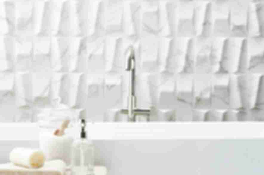 Sculptural white ceramic bathroom tile.