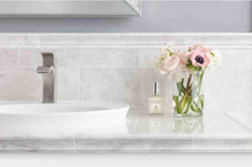 ceramic tiles surrounded wash basin.