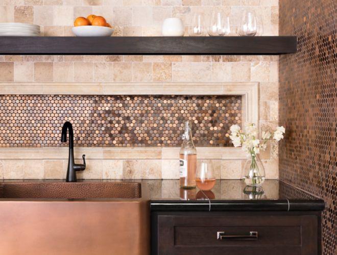 Kitchen backsplash with copper metallic tile.