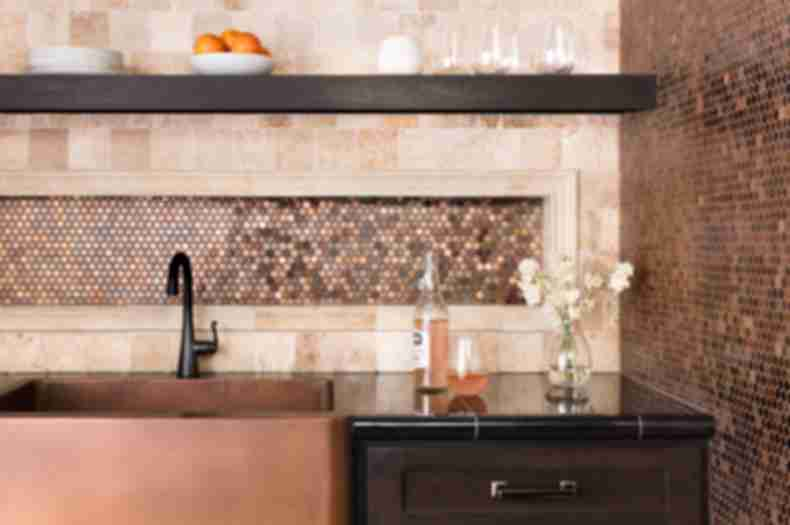 Kitchen backsplash with copper metallic tile.