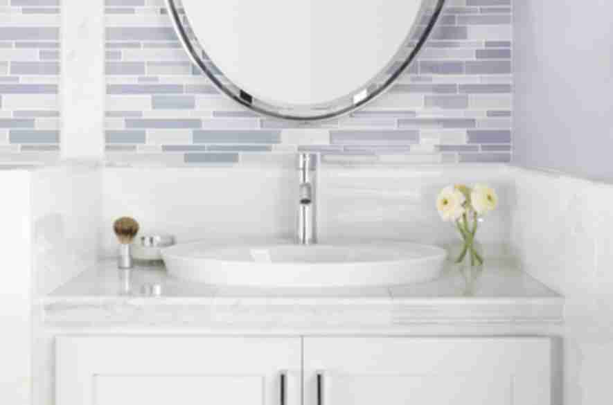 white marble tiles bathroom wash basin.