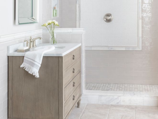 Bright and coastal bathroom with warm grey and white tile.