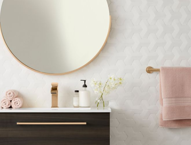 3-D, geometric white wall tile in contemporary and feminine bathroom.