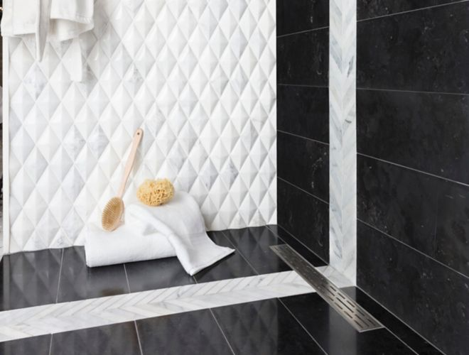 Black and whtie shower with 3-D diamond marble wall tile with black marble wall and floor tile.
