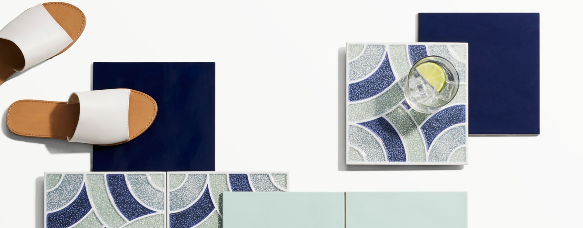 Assortment of blue and green pool tile.