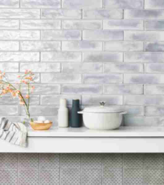 Grey glossy subway tile kitchen