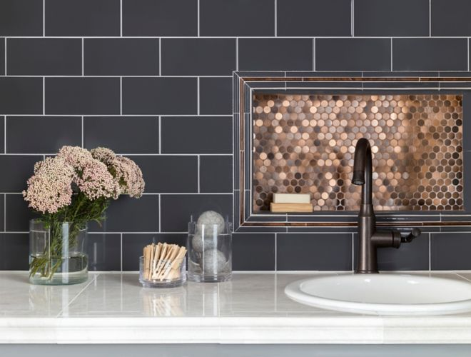 Laundry room backsplash with blue subway tile and metallic copper penny round mosaic.