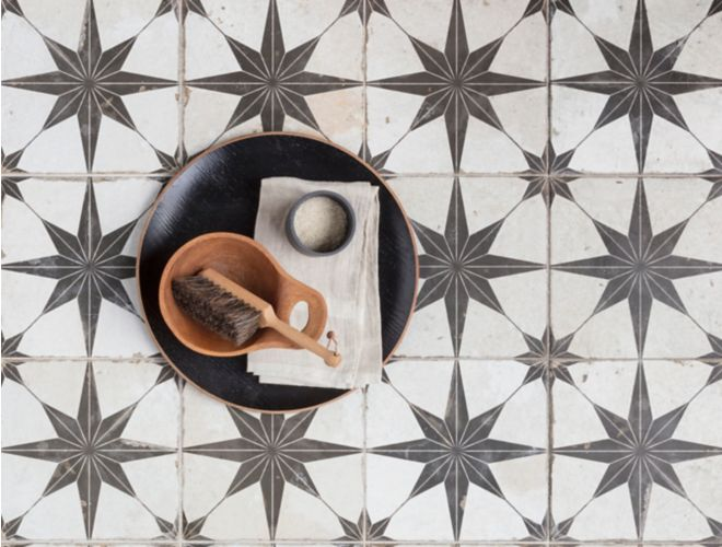 Black and white star encaustic floor tile.