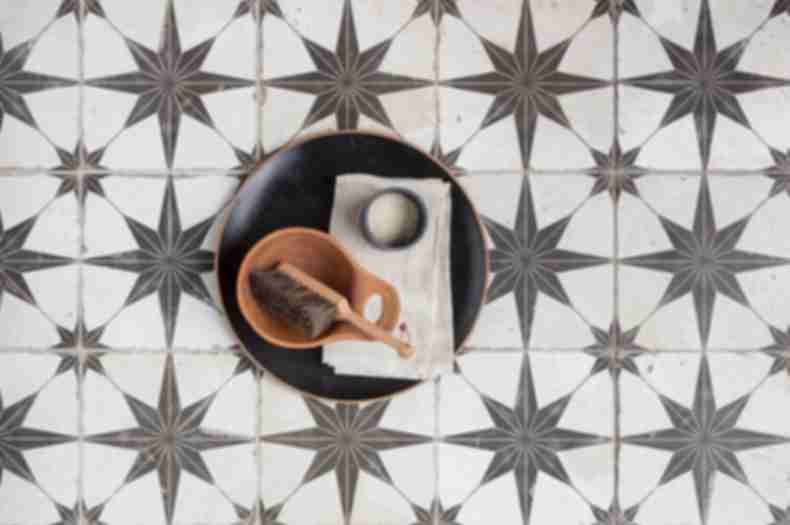 Black and white star encaustic floor tile.