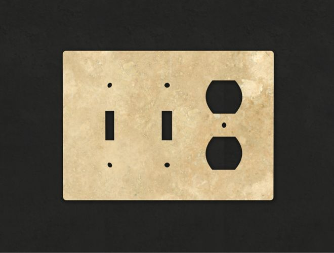 Beige natural stone switchplate for lights and outlets.