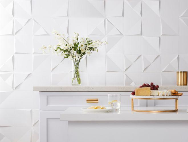White 3-D ceramic wall tile.