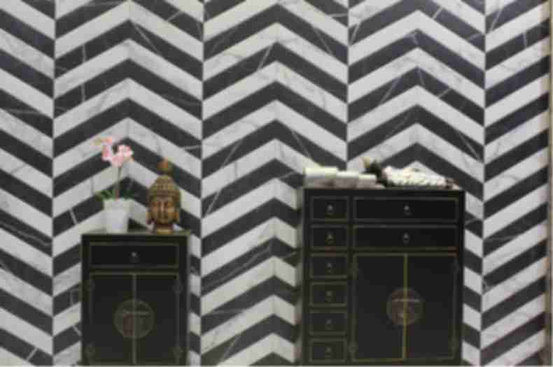 Black and white porcelain chevron wall tile.