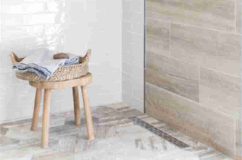Shower with wood look tile.