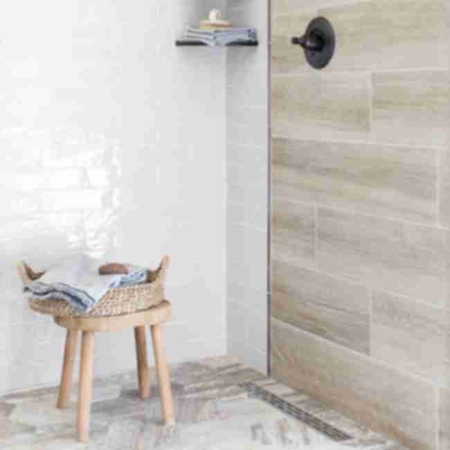 Shower with faux wood and subway tile.