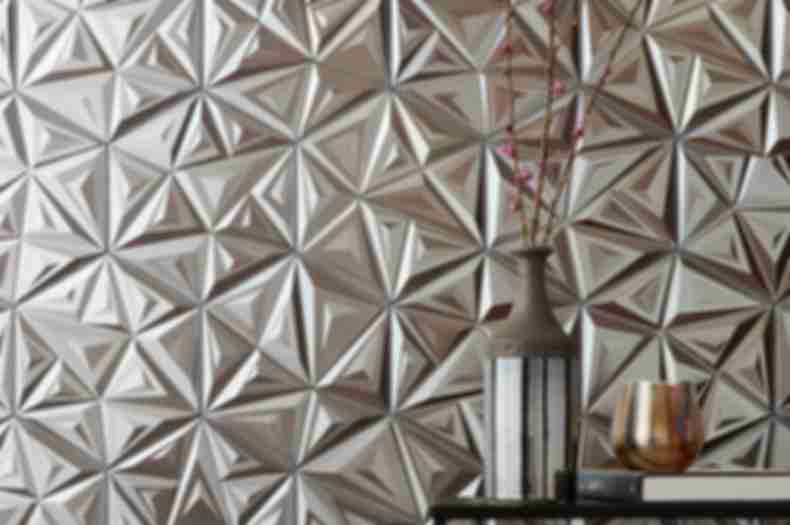 Metallic silver, 3-D geometric wall tile in contemporary entry way.