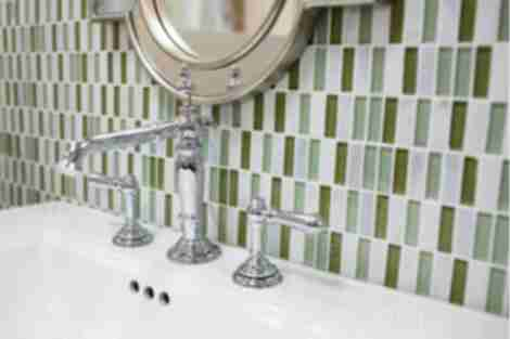 green and grey bathroom wall tiles.