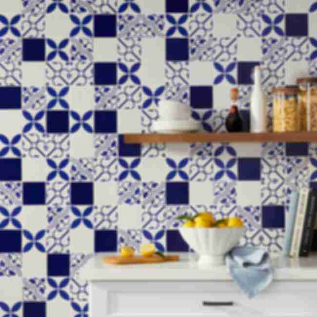 Blue and white kitchen with patterned tile.