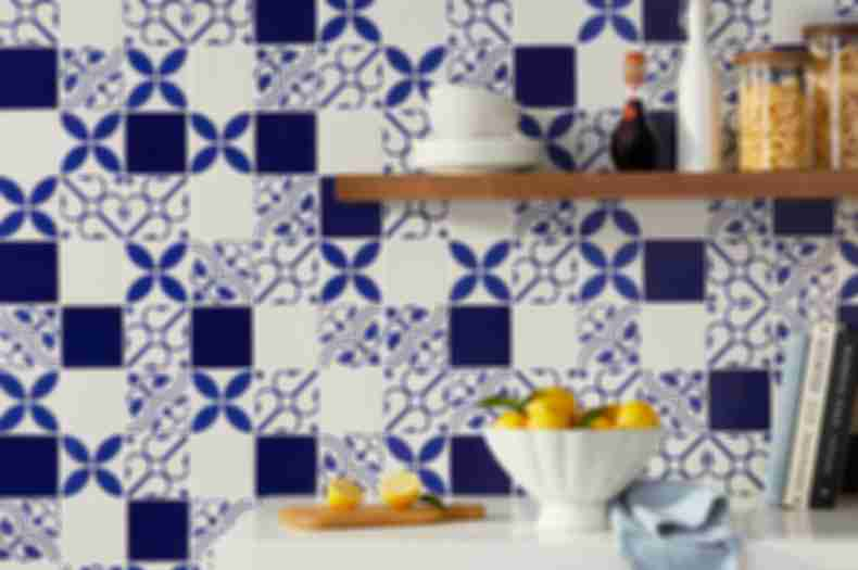 Mediterranean kitchen with blue and white patterned wall tile.