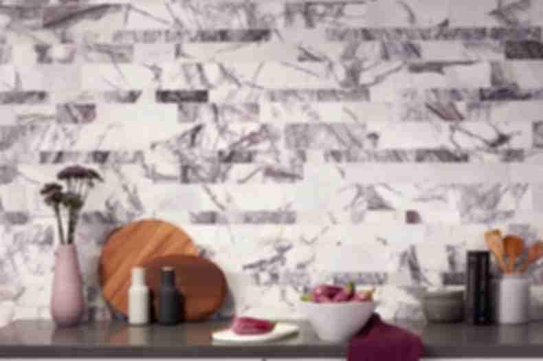 White marble with purple veining in kitchen backsplash.