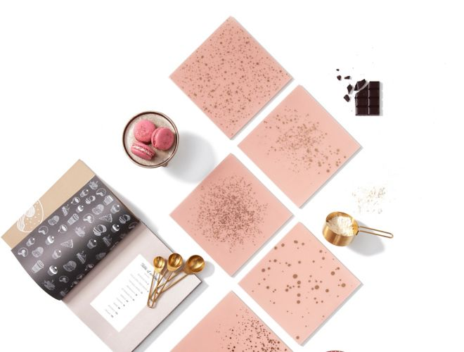 Blush pink glass tile with gold speckles.