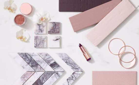 Pink ceramic subway tiles, blush porcelain tile, and white marble mosaics with purple veining with flowers and lipstick.