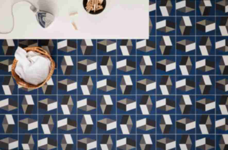 Blue patterned laundry room tiles.