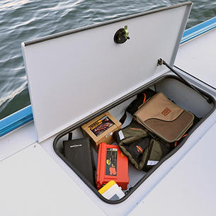 1875-1975 Renegade Bow Deck Port Storage Compartment shown with Gray Lund Guard Floor and Interior Option