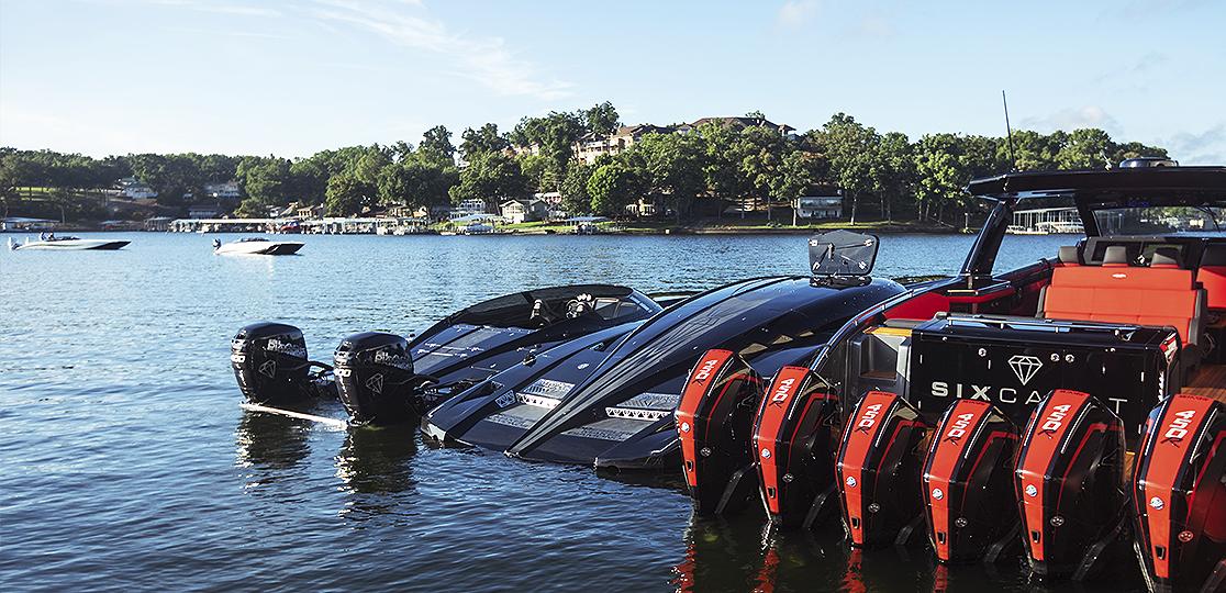 Black red boats lake houses Mercury 450 r outboard motors